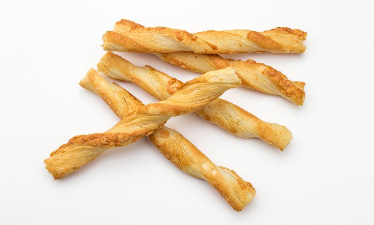crunchy Cheese Straws on white background