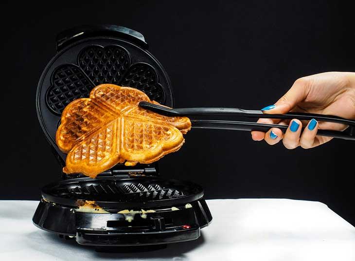 Person making fresh waffles